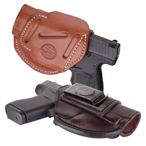 Buy-Guns-Two black pistols with brown leather holsters on white background