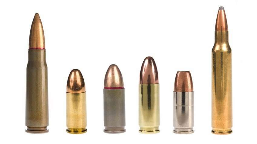 6 gold and silver bullets standing upright with white background