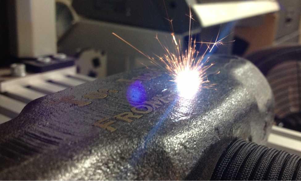 close-up image of laser engraving on metal