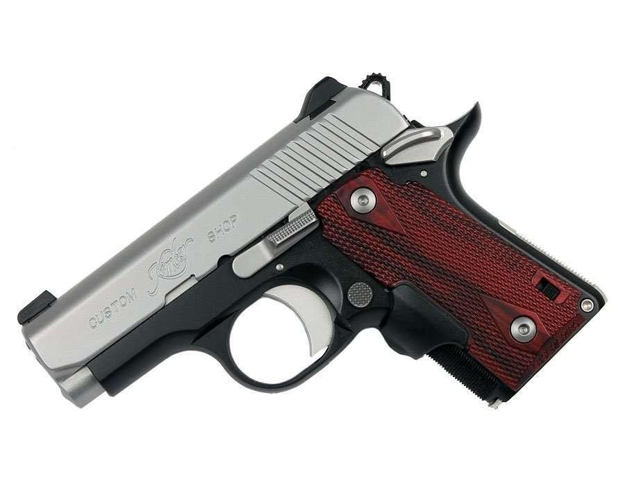 Kimber handgun with white background